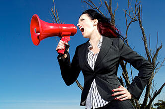 Woman_promoting_her_successful_small_business_with_megaphone