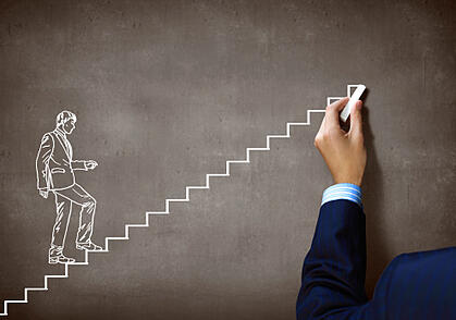 businessman_climbing_stairs_to_build_a_successful_small_business_180923589