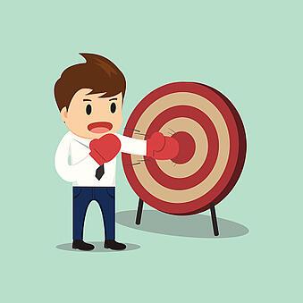 business_man_hitting_target_516910349