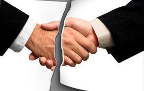 broken_trust_business_hand_shake_ripped_in_half