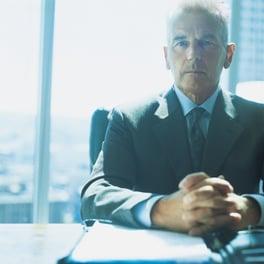 Boss_sitting_behind_desk