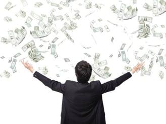 Businessman_throwing_money