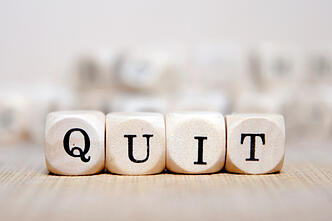 QUIT_spelled_out_on_wooden_dice