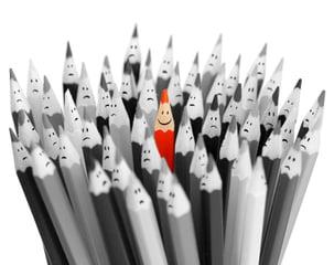 red_smiling_pencil_among_sad_gray_pencils