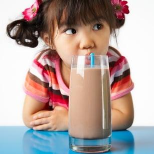 little_girl_drinking_chocolate_milk