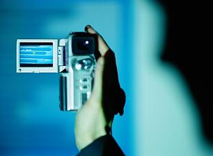 person_holding_camcorder