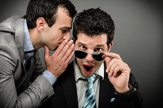 Two_business_men_sharing_trade_secrets