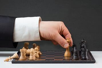 business_man_playing_chess