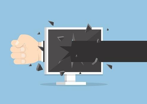 hand_punching_through_computer.jpg