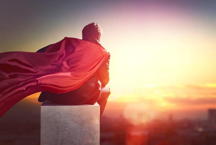 businessman dressed as super hero